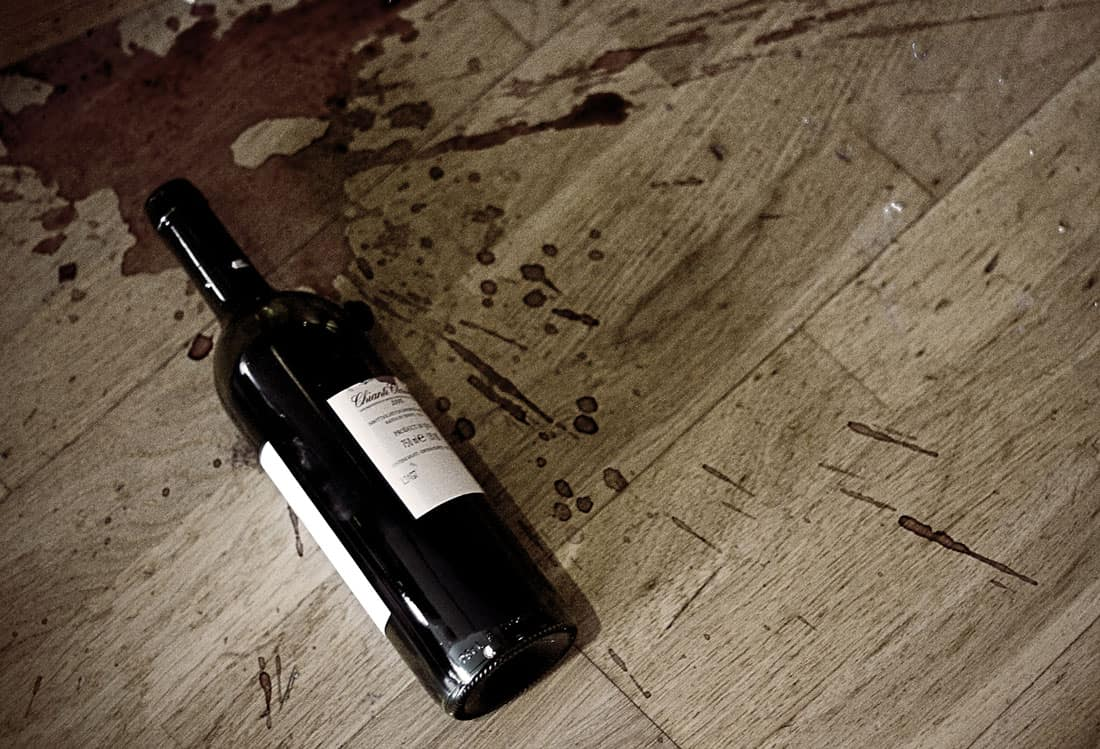 Bottle of red wine on the floor
