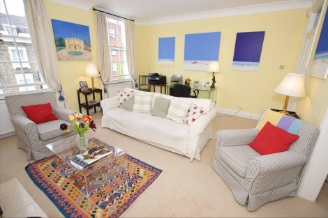 Beautifully decorated with a patterned rug and fun artwork