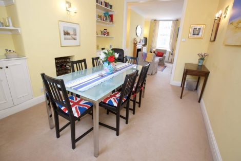 The dining table comfortably seats up to six